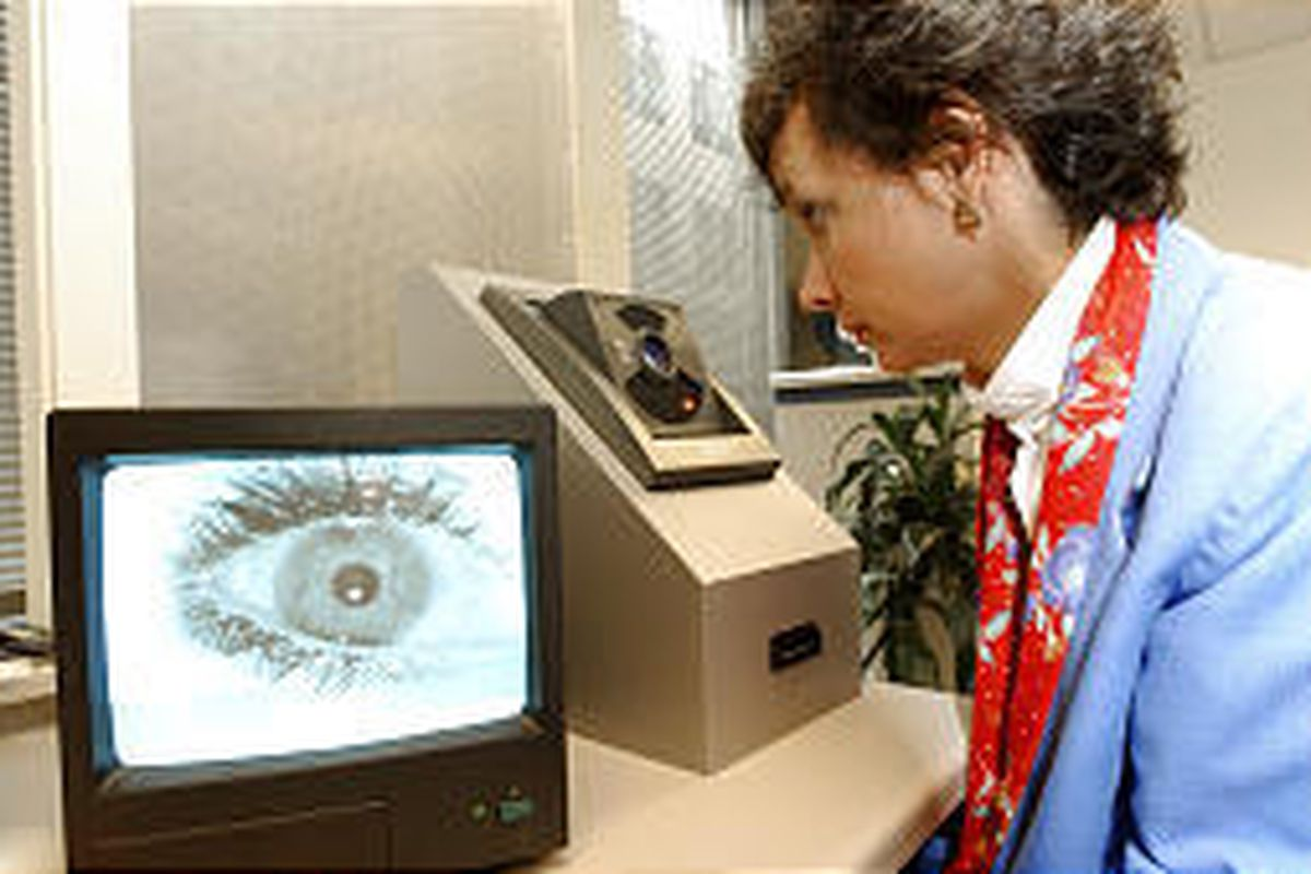 IBM security specialist Cindy Dalton tests a retina-scanning system in Washington, D.C., that will help companies safeguard their complexes and employees.
