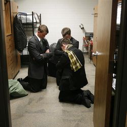 Clockwise from back left: Elders Samuel Miller, John Scoggin and Anthony Franklin pray in their room before they leave the Provo Missionary Training Center of The Church of Jesus Christ of Latter-day Saints in Provo, Utah Tuesday, Feb. 15, 2011.
