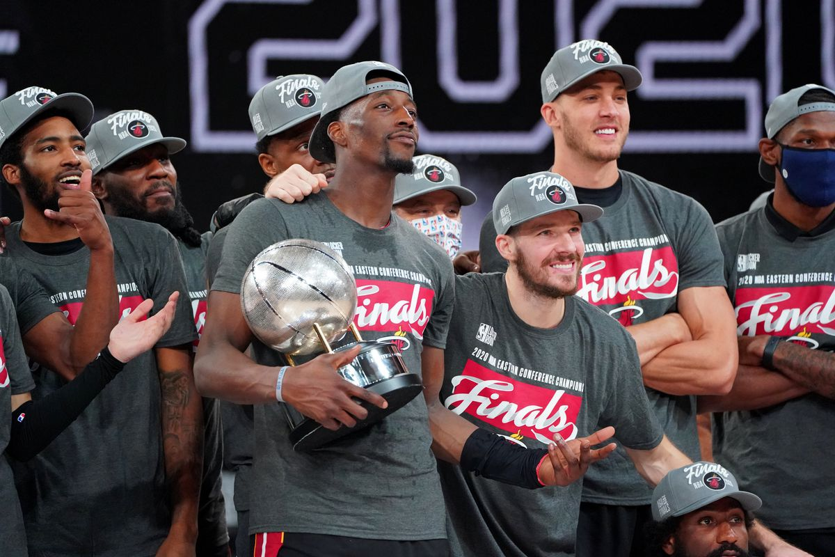 The Miami Heat pose for a photo with the Eastern Conference Finals trophy after Game Six of the Eastern Conference Finals of the NBA Playoffs on September 27, 2020 at the AdventHealth Arena at ESPN Wide World Of Sports Complex in Orlando, Florida.