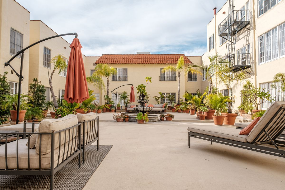 A large interior courtyard with lots of lounge furniture.