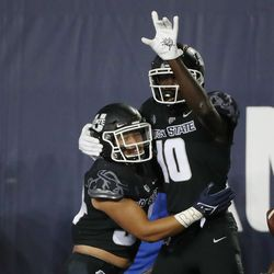Utah State Aggies wide receiver Justin McGriff (10) celebrate this touchwdown with Utah State Aggies running back Elelyon Noa (34) in Logan on Friday, Oct. 1, 2021.
