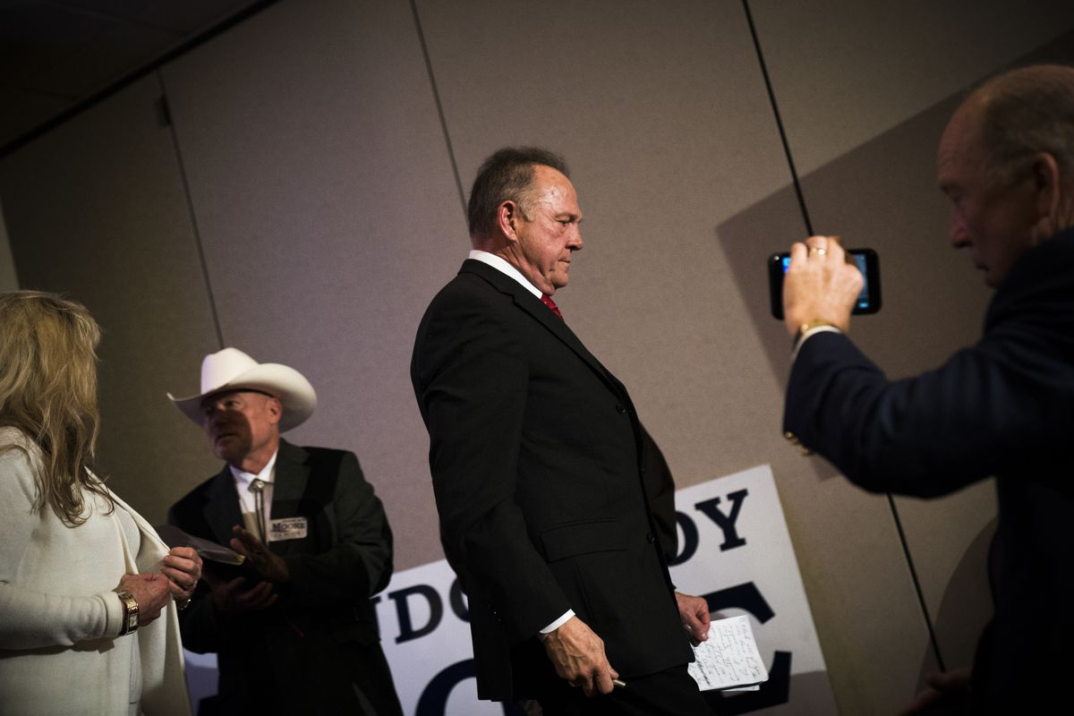 BIRMINGHAM, AL - NOVEMBER 16: Republican candidate for U.S. Senate Judge Roy Moore takes his seat after speaking during a news conference with supporters and faith leaders, November 16, 2017 in Birmingham, Alabama. Moore refused to answer questions regarding sexual harassment allegations and pursuing relationships with underage women. (Drew Angerer/Getty Images)
