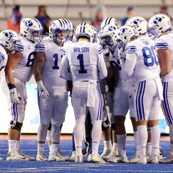 Brigham Young Cougars quarterback Zach Wilson (1) calls a play in the huddle as BYU and Boise State play a college football game at Albertsons Stadium in Boise on Friday, Nov. 6, 2020. BYU won 51-17.