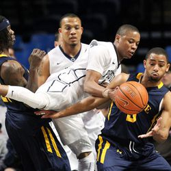 Penn State Nittany Lions guard Tim Frazier (23) and La Salle Explorers Tyreek Duren (3) fight for the ball