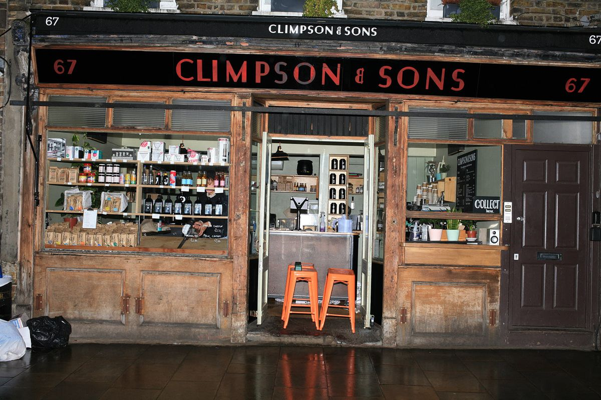 Climpson's and Sons cafe on Broadway Market, open but preparing to close at the end of the day on the first day of coronavirus lockdown in London