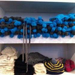 These pom pom scarves and hats are so adorable!