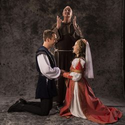 """Shane Kenyon, left, as Romeo, Jonathan Gillard Daly as Friar Lawrence and Betsy Mugavero as Juliet star in the Utah Shakespeare Festival's 2017 production of """"Romeo and Juliet."""""""