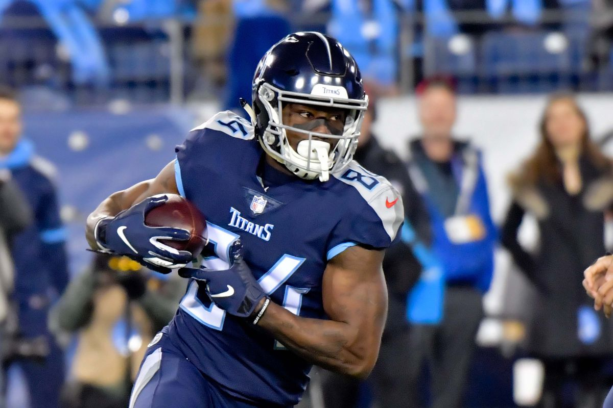 Tennessee Titans wide receiver Corey Davis runs with the ball against the Jacksonville Jaguars during the first half at Nissan Stadium.