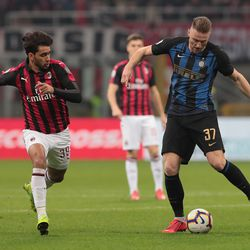 Milan Skriniar (R) of FC Internazionale is challenged by Lucas Paqueta of AC Milan during the Serie A match between AC Milan and FC Internazionale at Stadio Giuseppe Meazza on March 17, 2019 in Milan, Italy.