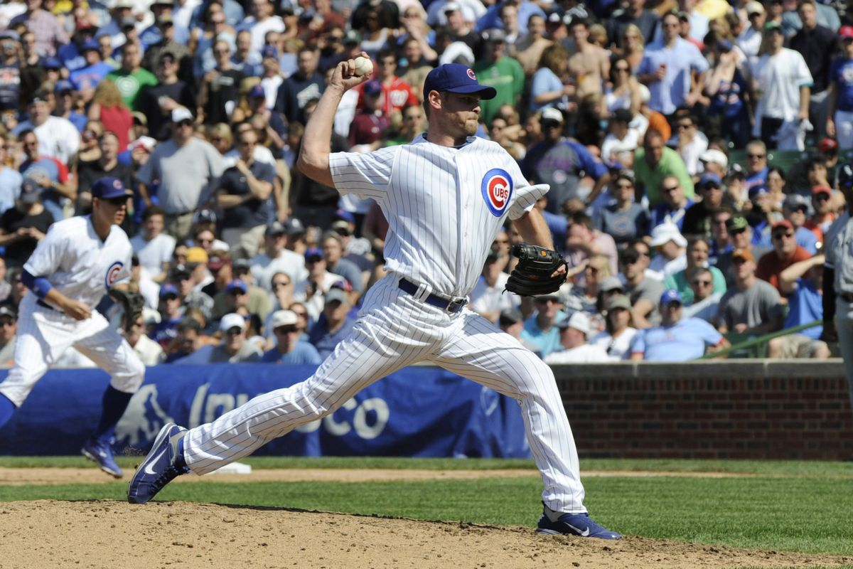 CHICAGO, IL - MAY 18: Kerry Wood #34 of the Chicago Cubs pitches against the Chicago White Sox  on May 18 2012 at Wrigley Field in Chicago, Illinois. Kerry Wood faced one batter that he struck out in the eighth inning. It was announced that Kerry Wood is retiring from baseball today.  (Photo by David Banks/Getty Images)