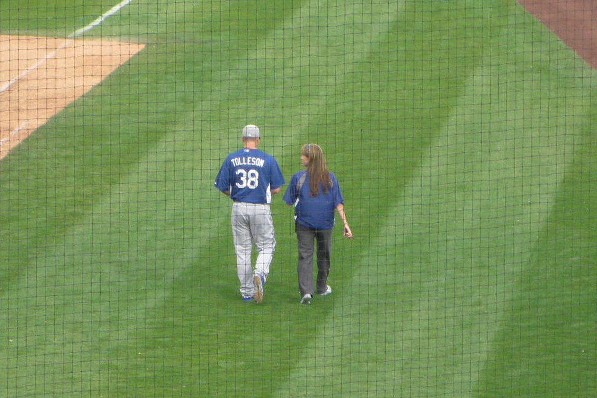 After the bottom of the eighth inning, Shawn Tolleson walked to the Dodgers clubhouse under his own power, along with Dodgers trainer Sue Falsone.