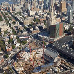 FILE - In this aerieal file photo of July 27, 2011, construction of the Barclays Center is underway for the new home of the Nets basketball team in the Brooklyn borough of New York. On Friday, Sept. 21, 2012, after decades without a professional sports team, New York City's ascendant borough is hitting the major leagues again - but this time it's basketball, not baseball, that's taking over.