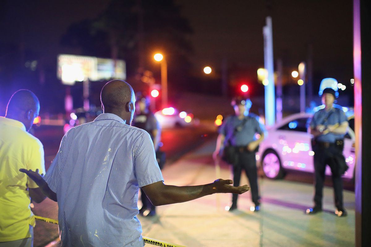 Ferguson man looks at the police.