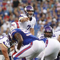 Aug 16, 2013; Orchard Park, NY, USA; Minnesota Vikings quarterback Christian Ponder (7) points on an audible against the Buffalo Bills at Ralph Wilson Stadium.