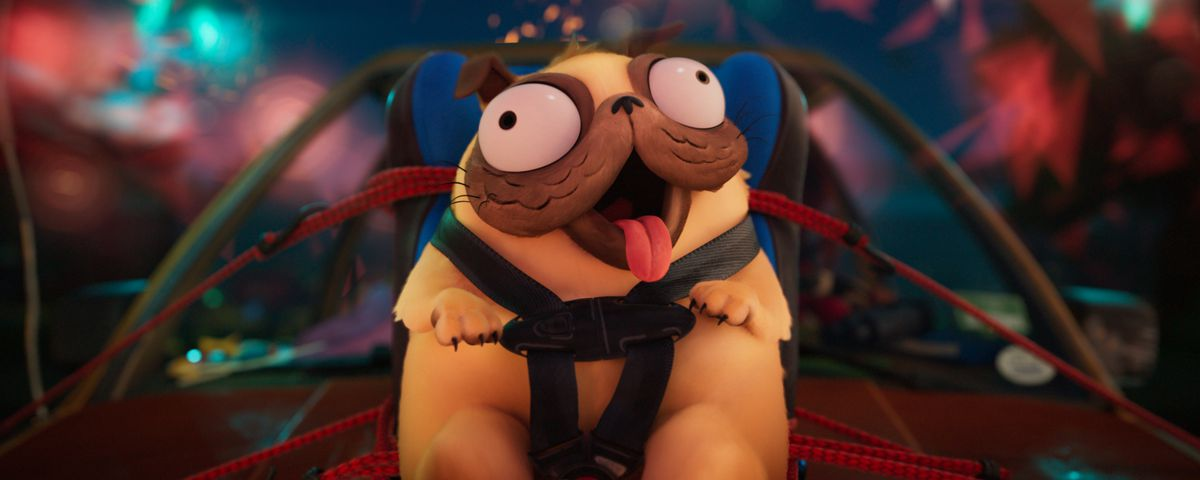 A close-up of Monchi the bug-eyed pug in The Mitchells vs. The Machines, strapped to a car hood with fireworks in the background