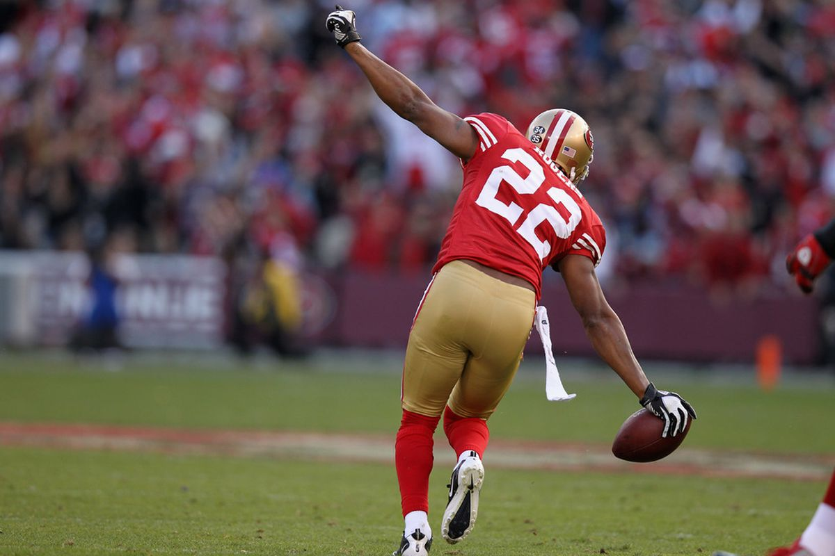 Carlos Rogers of the San Francisco 49ers celebrates after making an interception during their game against the New York Giants at Candlestick Park on November 13, 2011 in San Francisco, California.  (Photo by Ezra Shaw/Getty Images)