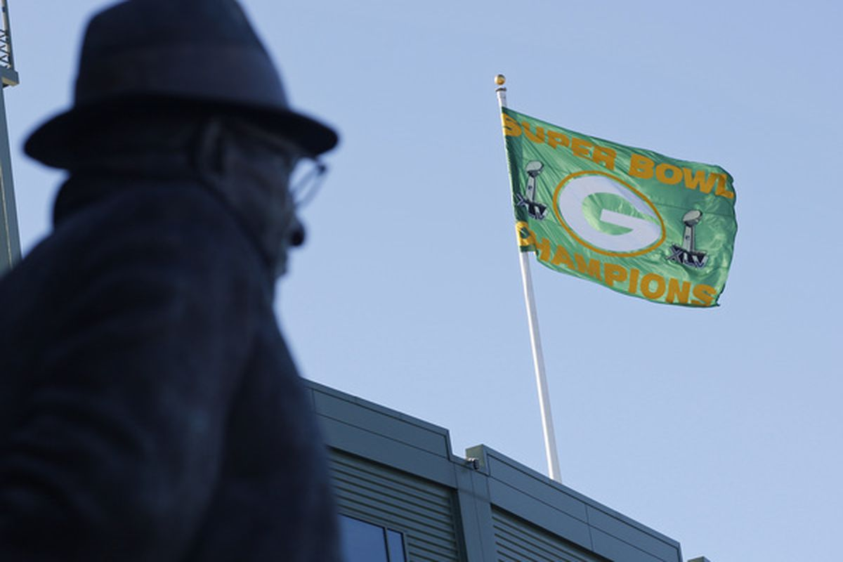 GREEN BAY WI - FEBRUARY 08:  A Green Bay Packers Super Bowl Champion flag flies over Lambeau Field on February 8 2011 in Green Bay Wisconsin.  (Photo by Matt Ludtke/Getty Images)