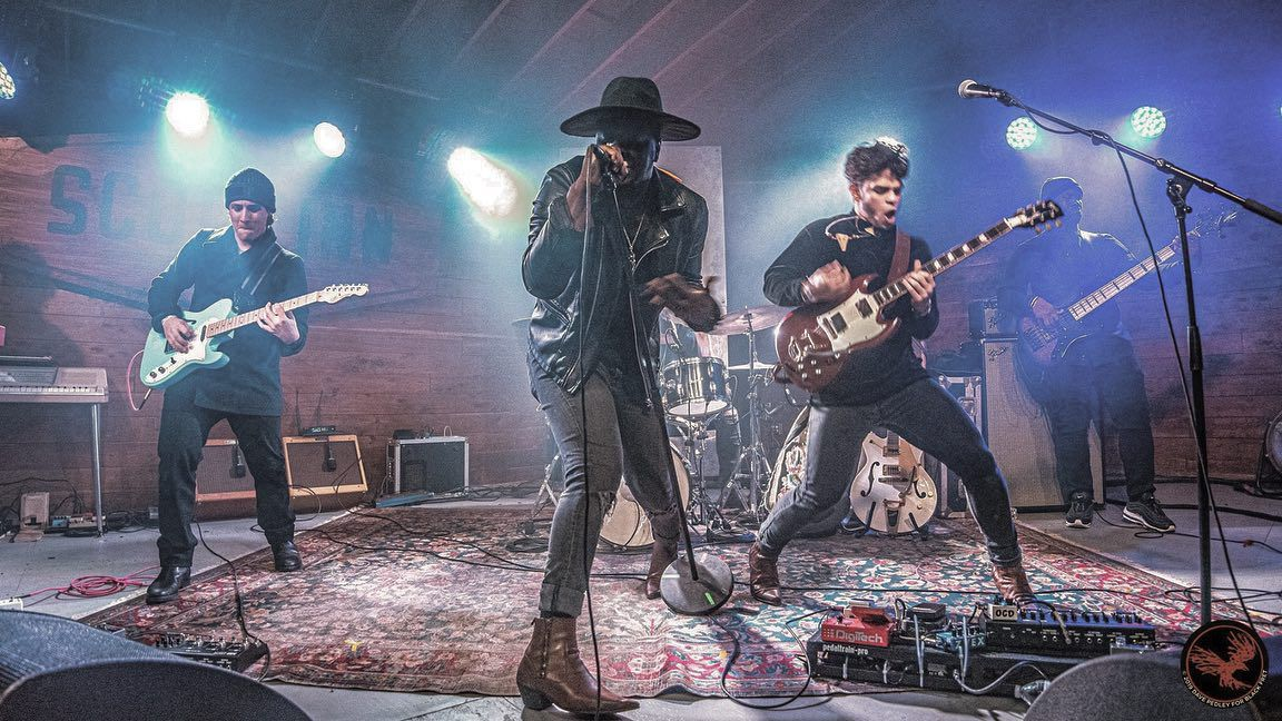 Sam Houston & BLK Odyssy performing