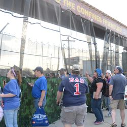 4:47 p.m. Fans lined up along the privacy curtain -