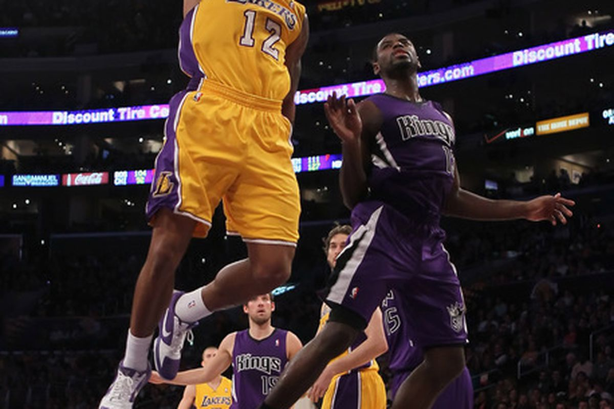LOS ANGELES CA - DECEMBER 03:  Shannon Brown #12 of the Los Angeles Lakers drives to the basket past Tyreke Evans #13 of the Sacramento Kings for a dunk during the first half at Staples Center on December 3 2010 in Los Angeles California.
