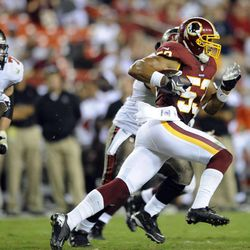 Washington Redskins linebacker Bryan Kehl (53) runs with his interception during the second half of an NFL preseason football game with the Tampa Bay Buccaneers Wednesday, Aug. 29, 2012, in Landover, Md. (AP Photo/Nick Wass)