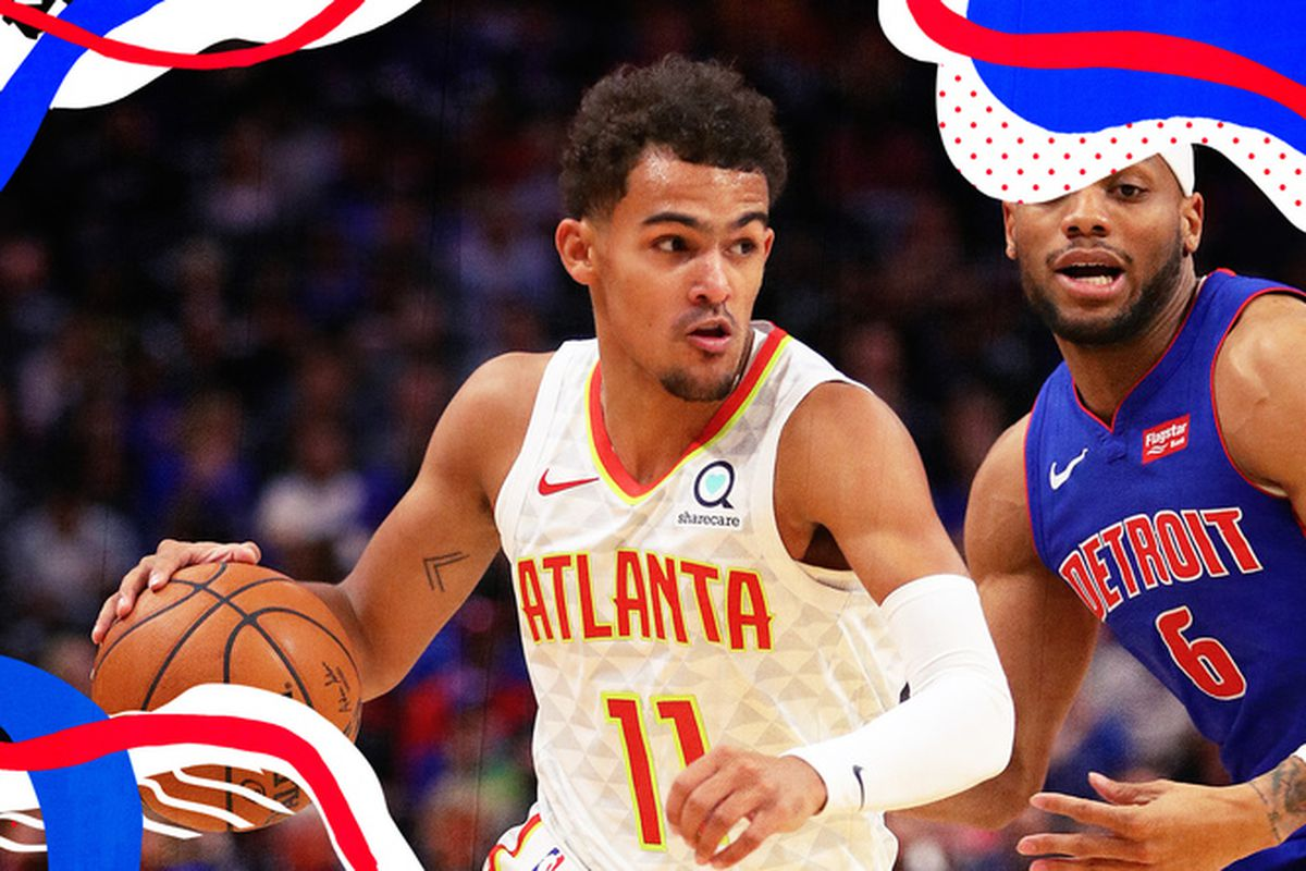 Trae Young drives on the Pistons.