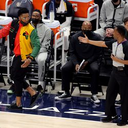 Utah Jazz guard Donovan Mitchell (45) is directed to the end of the bench by referee James Capers (19) as the Utah Jazz and the Memphis Grizzlies play in game one of their NBA playoff series at Vivint Arena in Salt Lake City on Sunday, May 23, 2021.