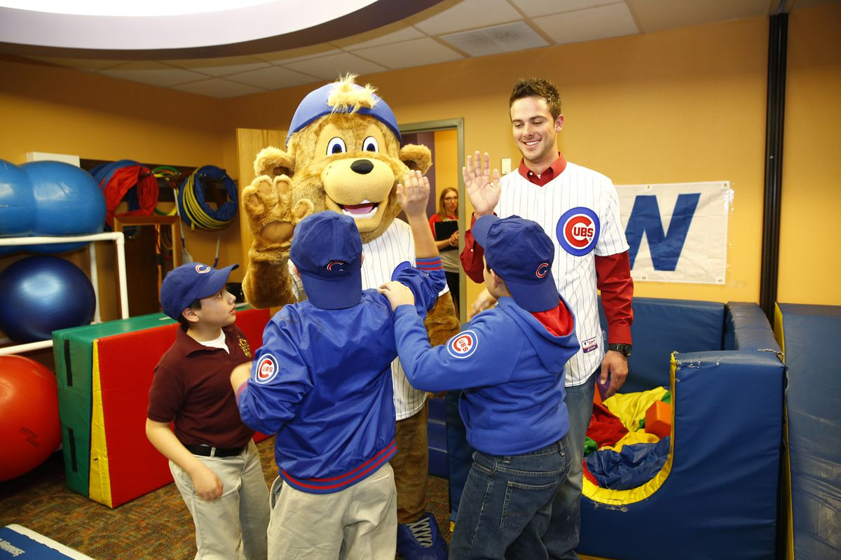 New Cubs mascot, Clark, and Cubs prospect Kris Bryant, high five with children at Advocate Illinois Masonic's Pediatric Developmental Center in Chicago