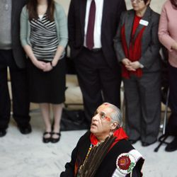 """Lacee Harris, a Native American shaman, conducts a """"blessing ceremony"""" to mark the first day of Interfaith Month at the Utah State Capitol in Salt Lake City on Friday, Feb.1, 2013."""