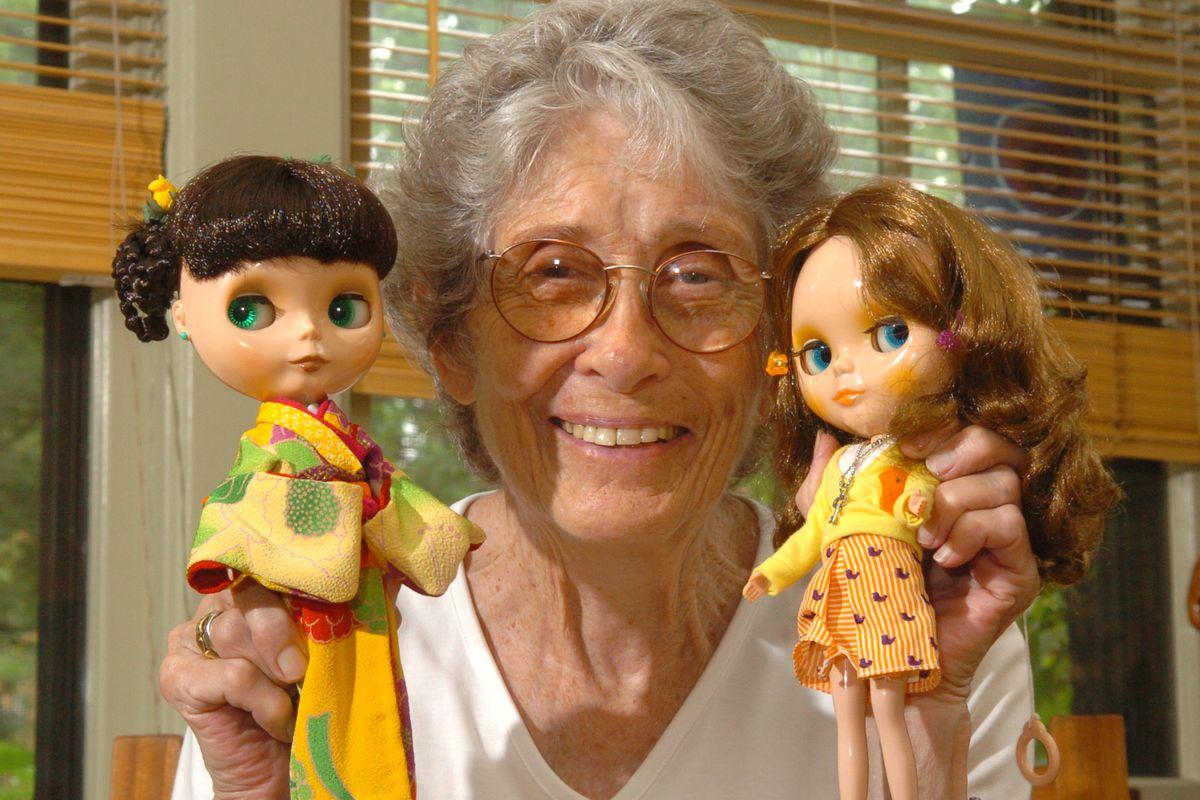 Allison Katzman with a Blythe doll in a handmade kimono and a Birdie Blue Blythe.