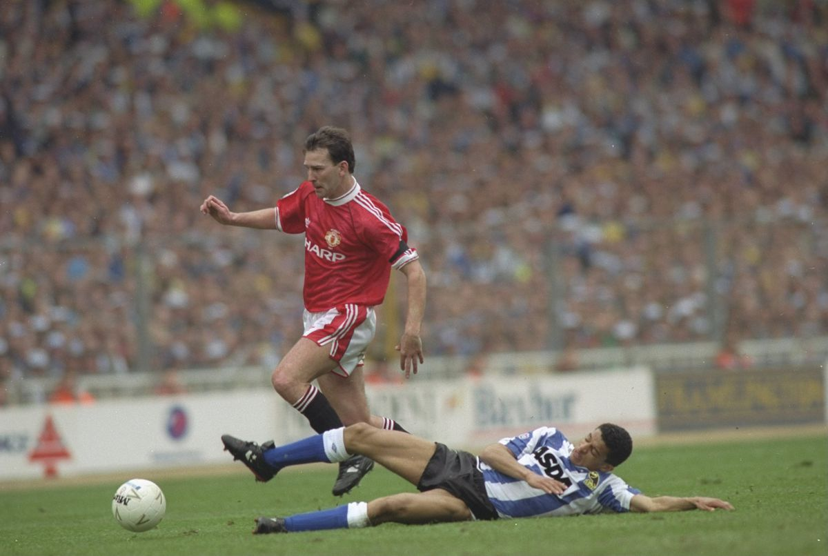 Bryan Robson of Manchester United and Paul Williams of Sheffield Wednesday