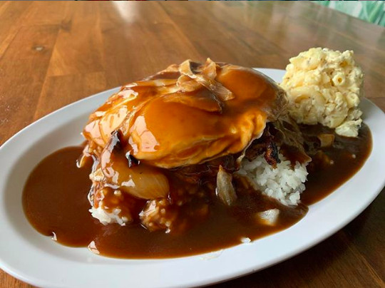 Rice, burger patty, and eggs drenched in gravy.
