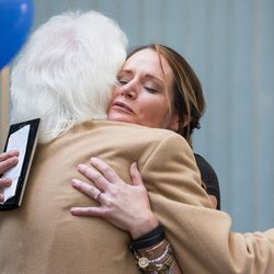 Alex McDonald, director of public education and public relations for Intermountain Donor Services, hugs Keri Stephens, whose son Anthony Whitaker donated organs and tissue after his death, at a ceremony hosted by Intermountain Donor Services in Salt Lake City on Wednesday, Dec. 21, 2016.