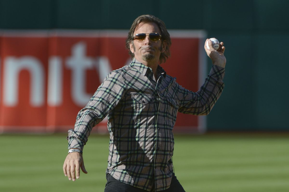 Jonathan Cain of Journey throws out the first pitch