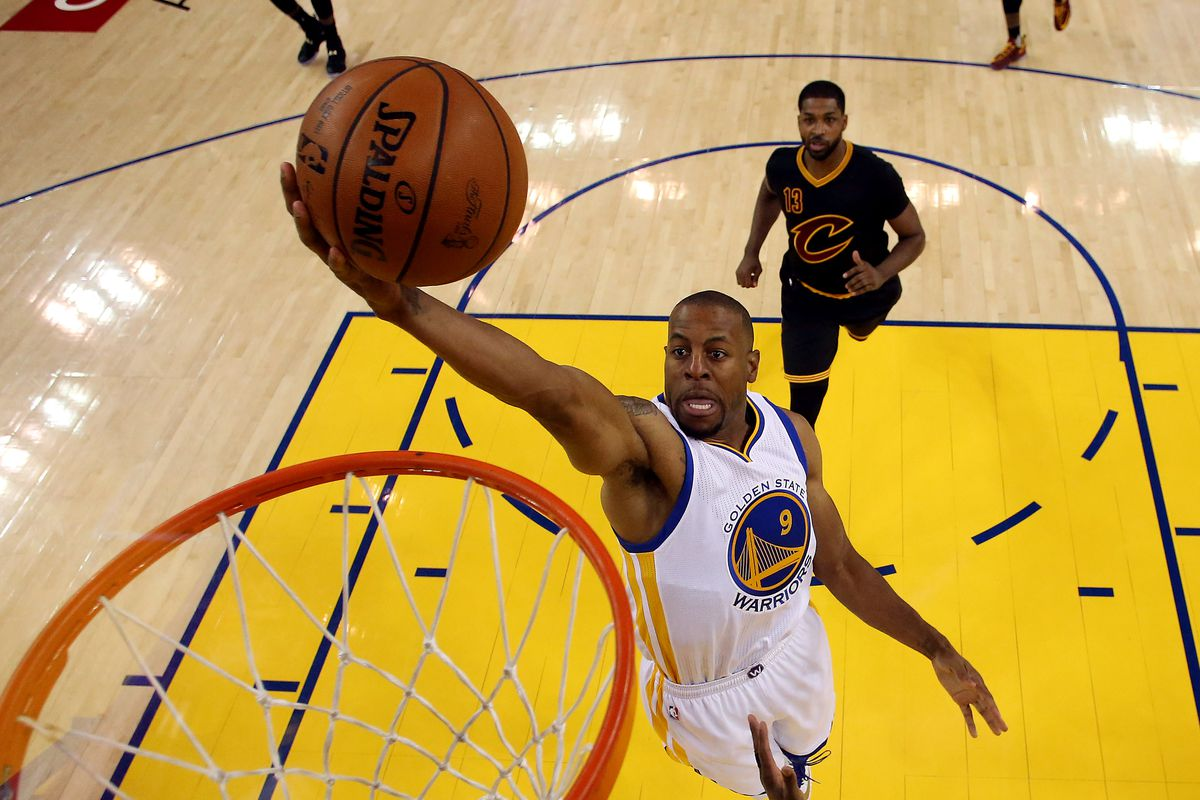 Andre Iguodala soars to the rim ahead of the pack.