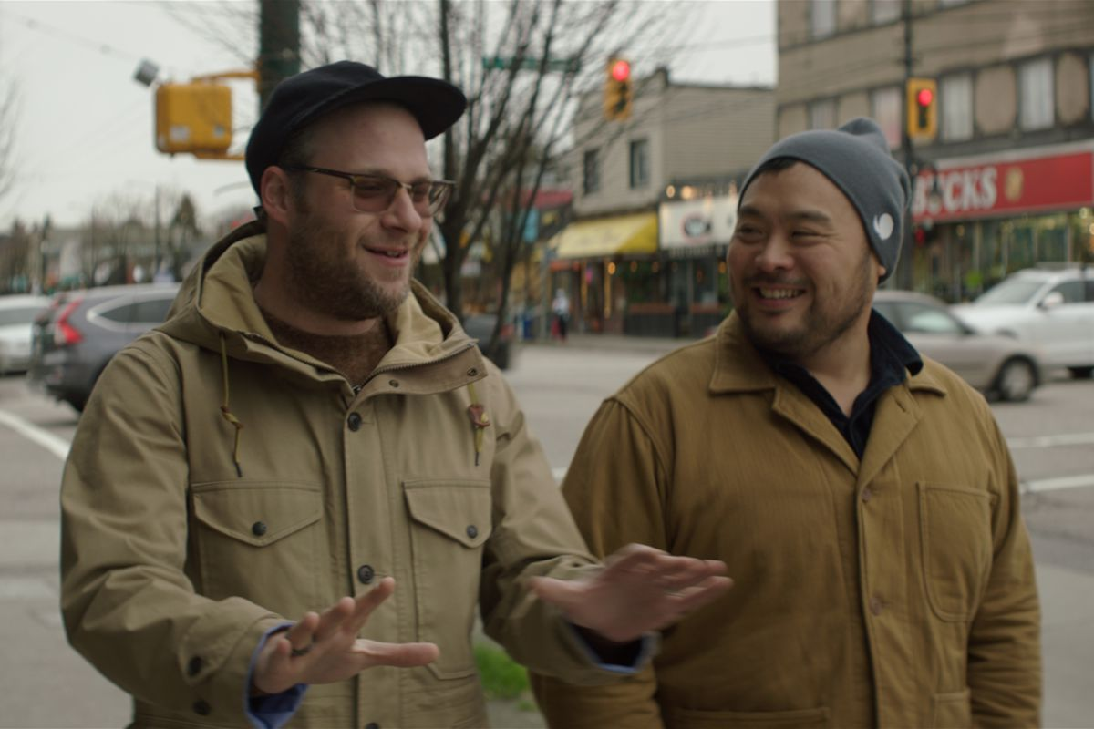 Seth Rogen and David Chang smiling on the streets of Vancouver.