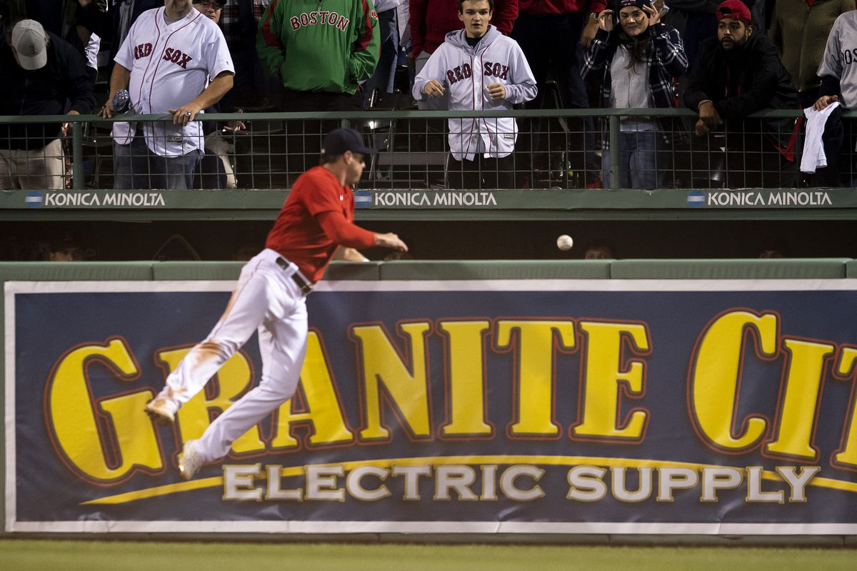 Hunter Renfroe #10 of the Boston Red Sox reacts as a ball is ruled a ground rule double during the thirteenth inning of game three of the 2021 American League Division Series against the Tampa Bay Rays at Fenway Park on October 10, 2021 in Boston, Massachusetts.