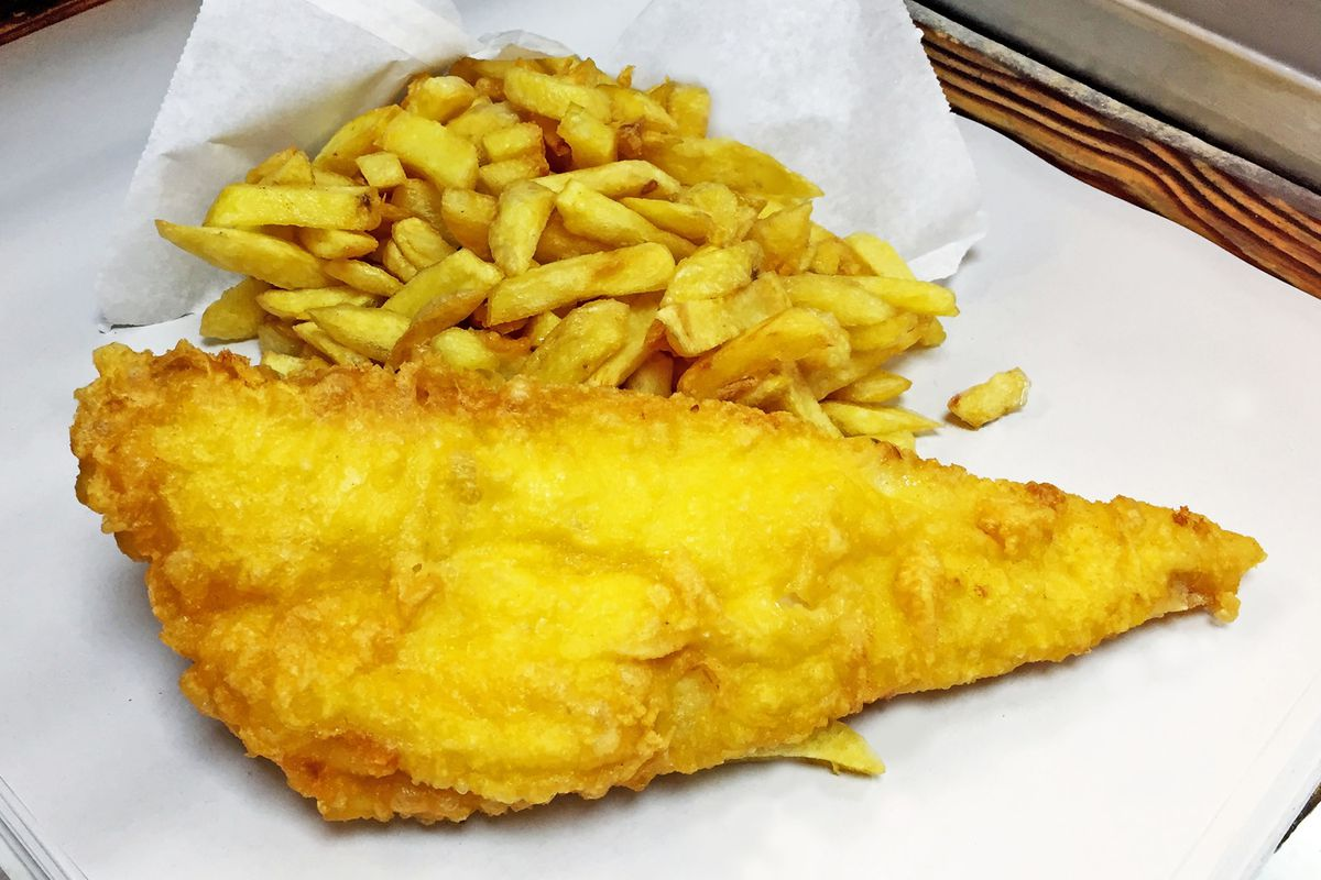 Fish and chips on greaseproof paper