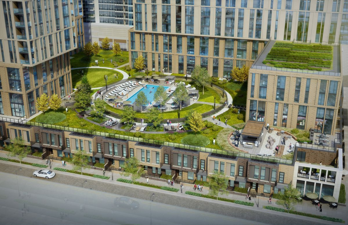 An aerial image of an elevated pool deck surrounded by landscaping in between two residential towers.
