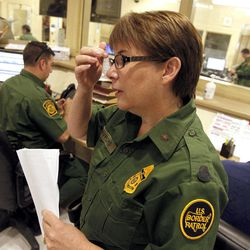 U.S. Border Patrol Tucson Sector Branch Chief Donna Twyford examines an illegal immigrant's file as they are  processed at Tucson Sector U.S. Border Patrol Headquarters Thursday, Aug. 9, 2012, in Tucson, Ariz.  The U.S. government has halted flights home for Mexicans caught entering the country illegally in the deadly summer heat of Arizona's deserts, a money-saving move that ends a seven-year experiment that cost taxpayers nearly $100 million.