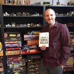 Dan Wells holds the novel that got his career as a professional writer started.