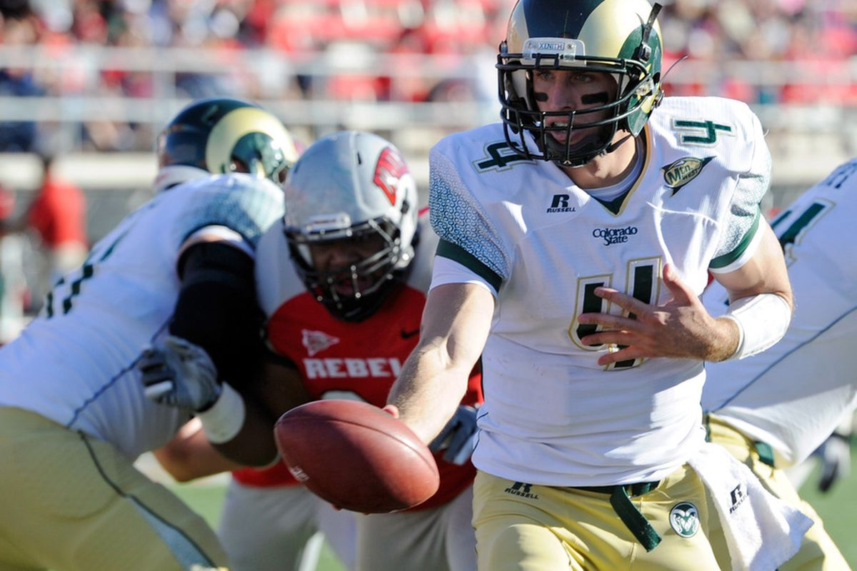 LAS VEGAS, NV - OCTOBER 29:  Quarterback Pete Thomas #4 of the Colorado State Rams goes to hand the ball off during a game against the UNLV Rebels at Sam Boyd Stadium October 29, 2011 in Las Vegas, Nevada.  (Photo by Ethan Miller/Getty Images)