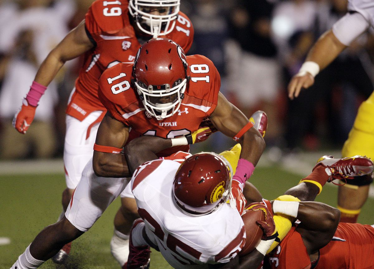 Utah Utes defensive back Eric Rowe (18) tackles USC running back Silas Redd during Pac-12 football in Salt Lake City Thursday, Oct. 4, 2012.