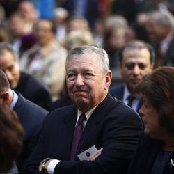 FILE -- In this Oct. 28, 2013 file photo, former U.S. Attorney General under President George W. Bush, John Ashcroft, attends the installation ceremony of James Comey as FBI director, in Washington. Qatar has hired Ashcroft's law firm for $2.5 million to audit its efforts at stopping terrorism funding. Papers filed with the Justice Department's National Security Division on Friday, June 9, 2017, show Ashcroft, will lead the effort.