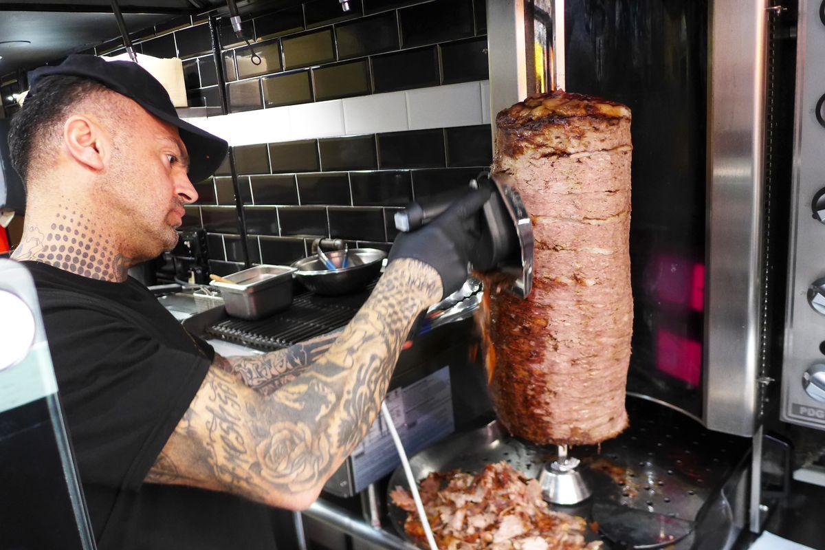 Slicing the Turkish doner kebab at Berlin Doner