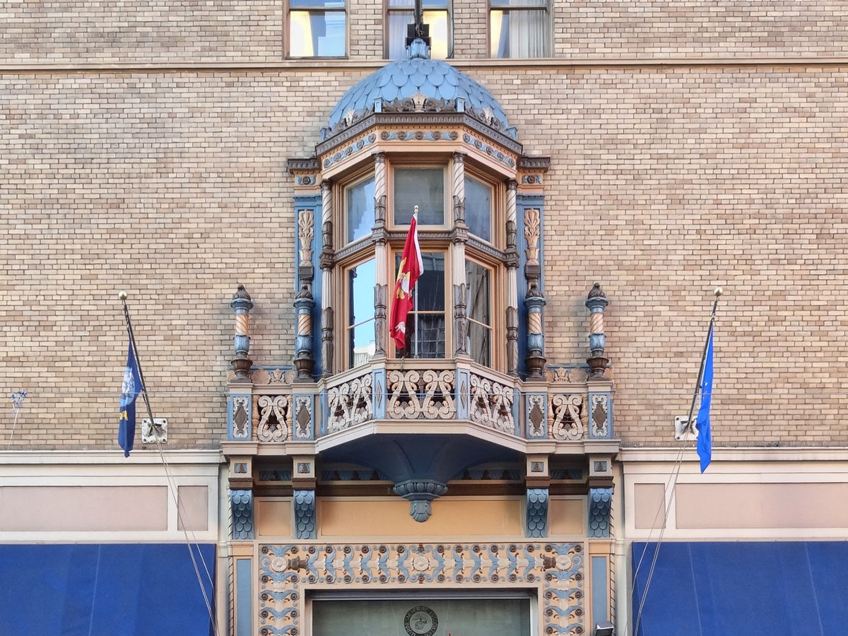 The exterior of Marines Memorial Club and Hotel. The door has an elaborately designed frame.