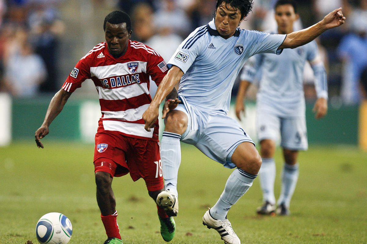 KANSAS CITY, KS - AUGUST 27:  Marvin Chavez of FC Dallas #18 and Roger Espinoza #15 of Sporting KC compete for the ball in the first half at Livestrong Sporting Park on August 27, 2011 in Kansas City, Kansas. (Photo by Ed Zurga/Getty Images)