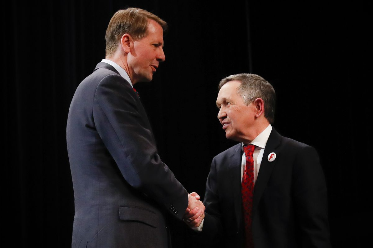 Richard Cordray (left) and Dennis Kucinich shake hands after the Ohio Democratic Party's fifth debate in the primary race for governor in Middletown, Ohio, on April 10, 2018.