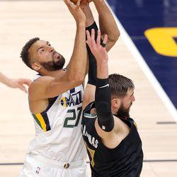 Utah Jazz center Rudy Gobert (27) battles Memphis Grizzlies center Jonas Valanciunas (17) for a rebound as the Utah Jazz and the Memphis Grizzlies play in game one of their NBA playoff series at Vivint Arena in Salt Lake City on Sunday, May 23, 2021.