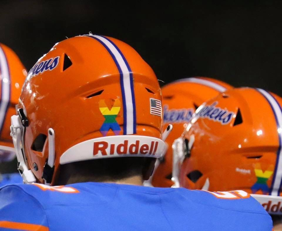 College football team with bi captain wears Pride stickers ...